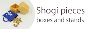 Shogi pieces, boxes and stands