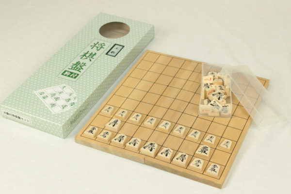 Set of foldable Shogi board and medium wooden pieces